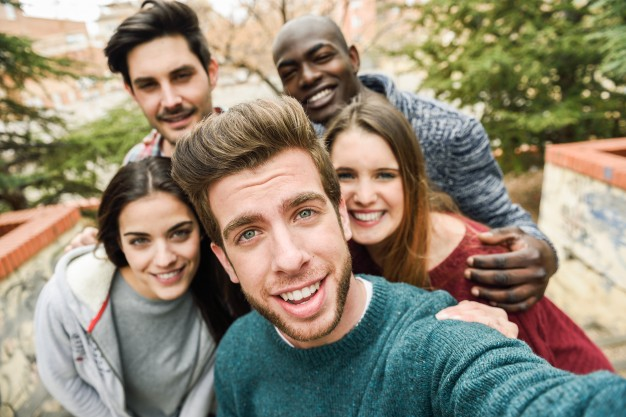 group-of-happy-friends-taking-a-photo_1139-267